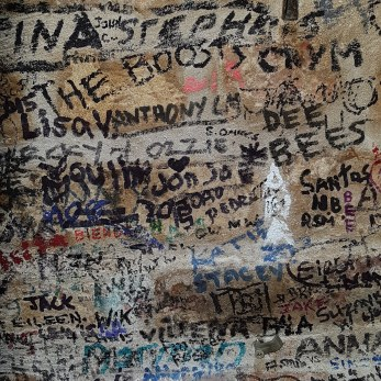 Visitors names scrawled across the walls